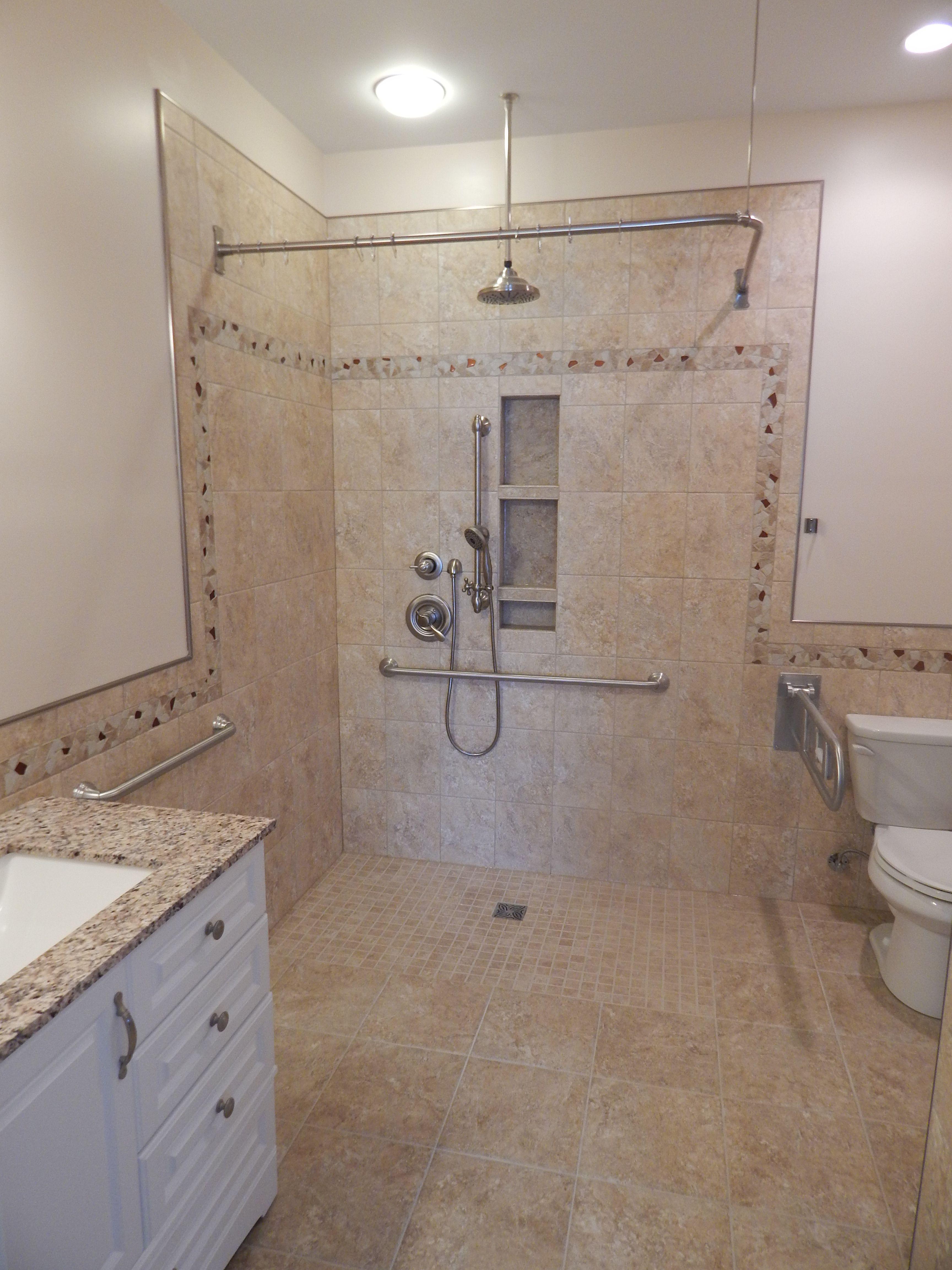 Custom barrier free bathroom with fold down grab bars