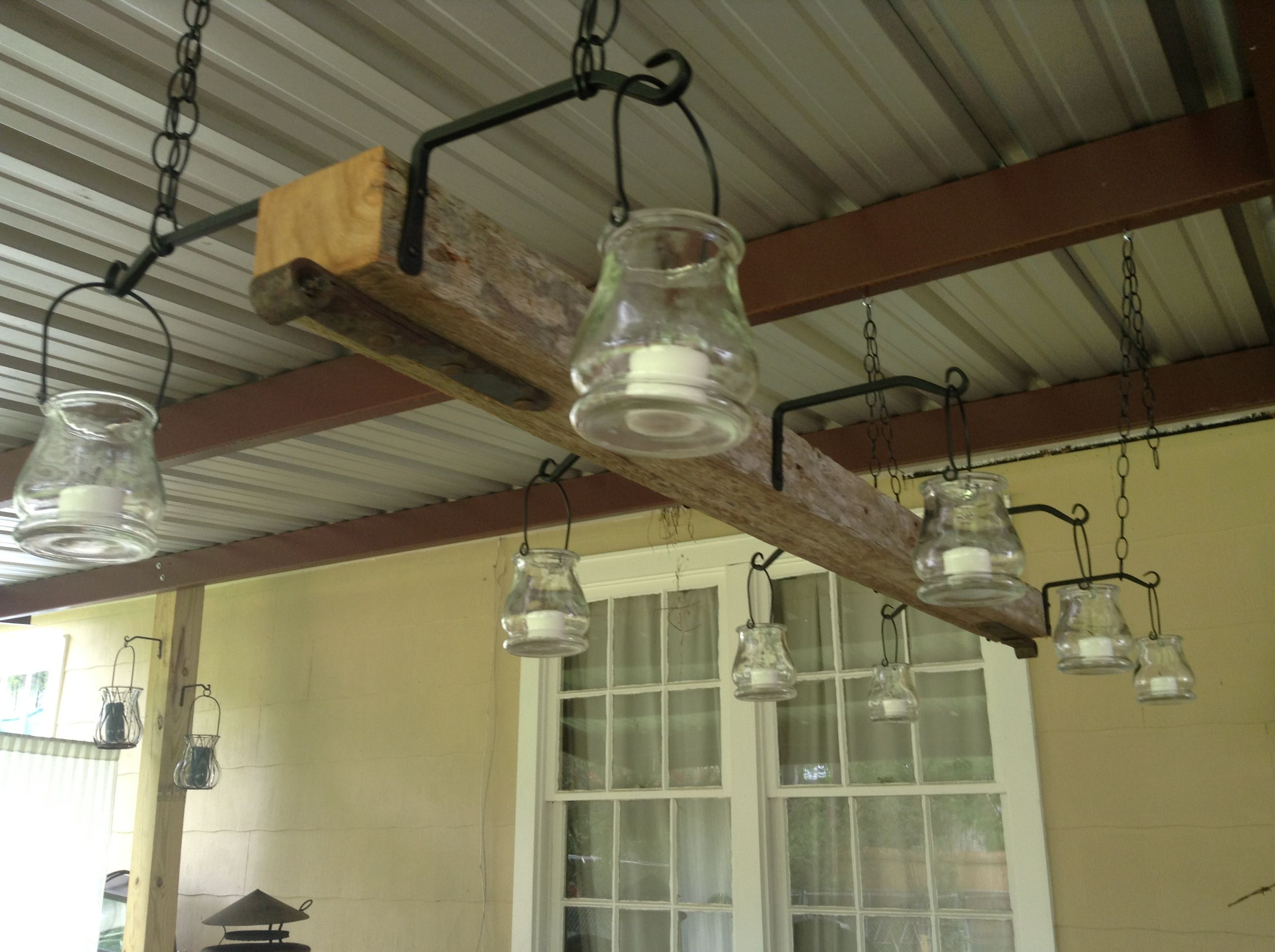 Outdoor Light Fixture We Made Using An Old Fence Post, Plant Holders From Lowe's And Mini