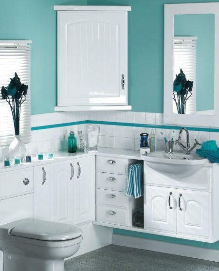 Using Bold Colors In The Bathroom: I'm Kind Of Digging The Bold Aqua Color Against The Stark White In This Bathroom.