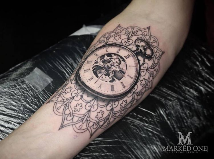 766b77463 Black and grey realism time piece pocket watch tattoo. Background of  mandala on forearm by Gav Guest of Marked One Tattoo.