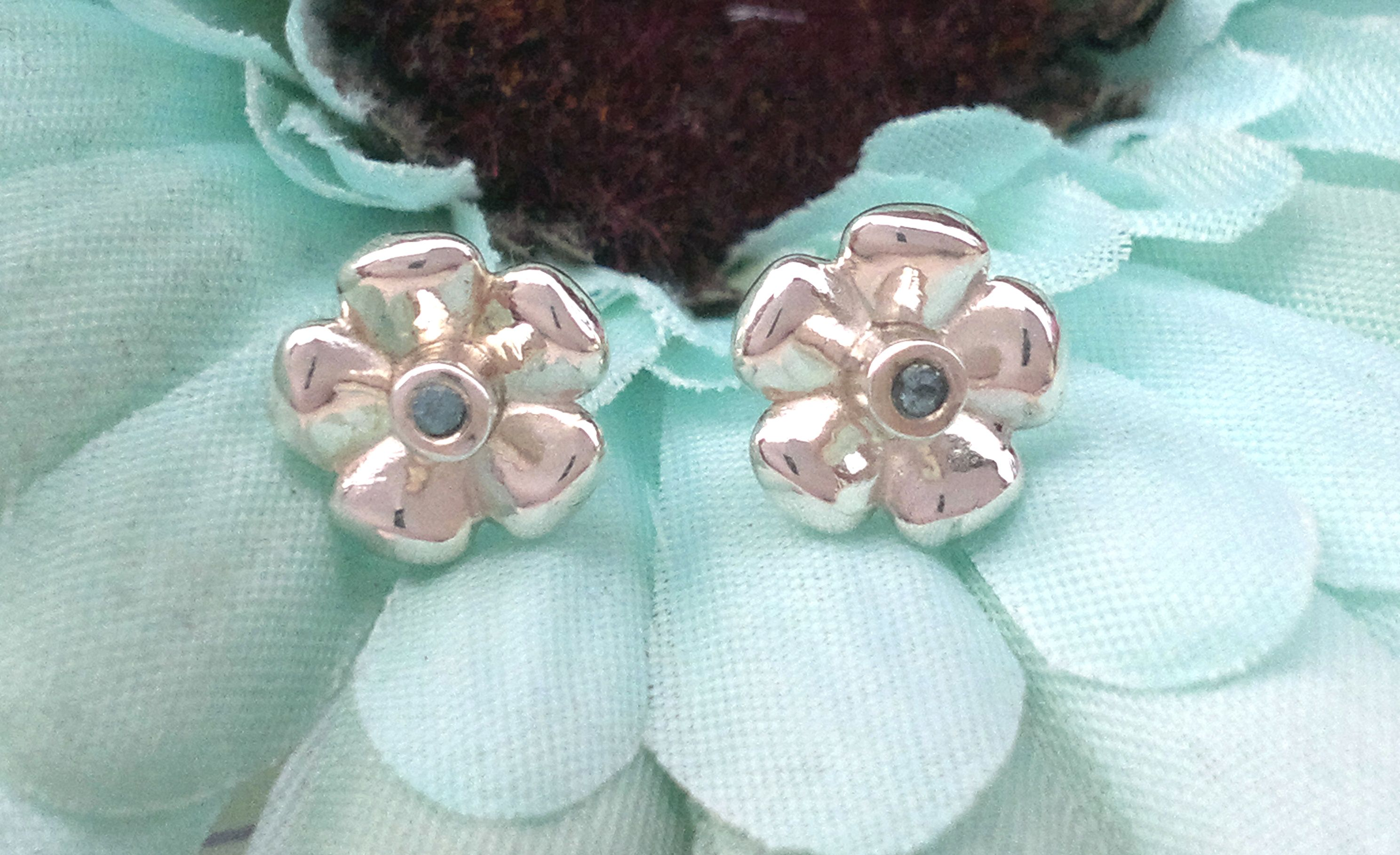 Our classic floral studs featuring blue topaz