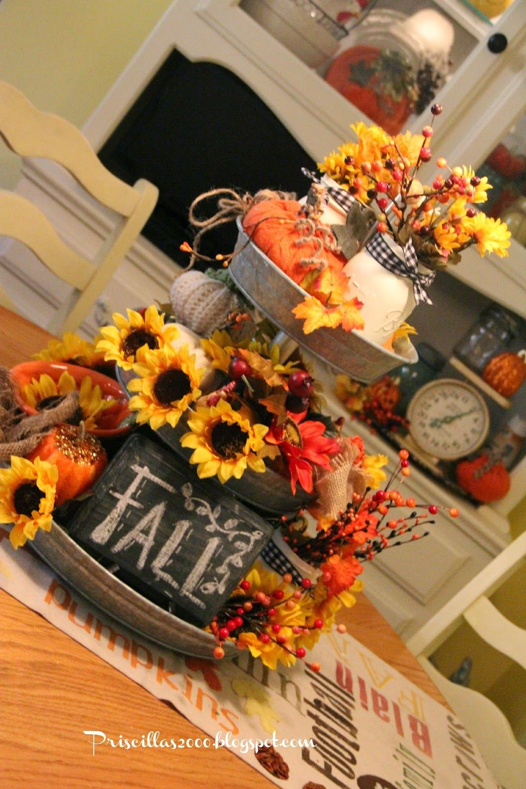 I am still loving this galvanized tray I got from Sam's club ! I have dressed it up for Fall     with sunflowers , fall berries and leav...