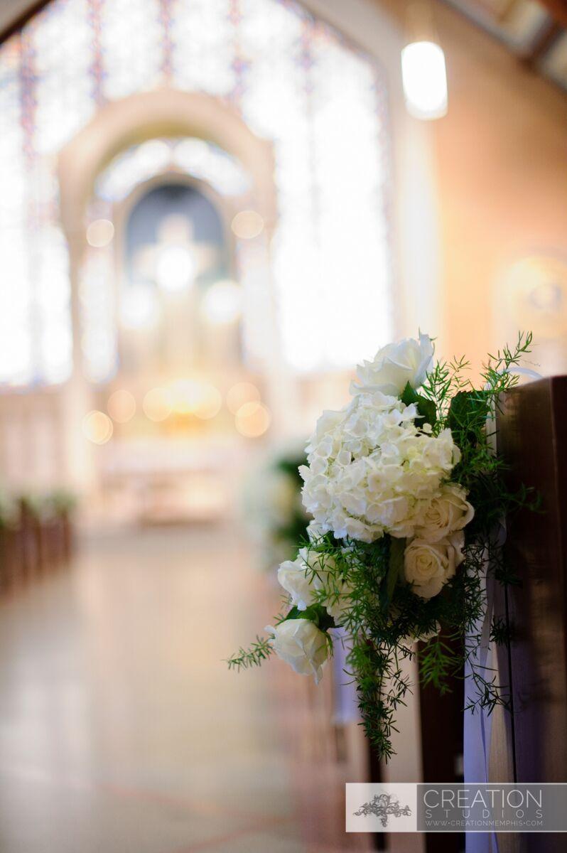 Aisle Detail with white floral arrangment
