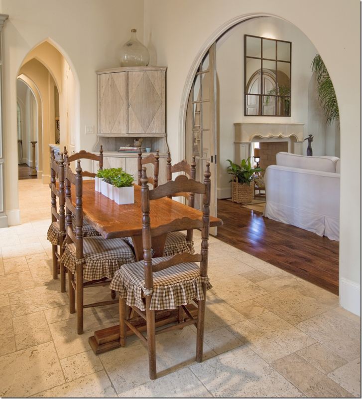 Glass pocket doors to family room, series of arches in ...