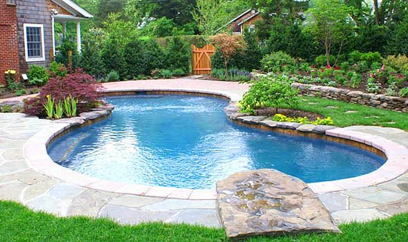 An oasis complete with charming stepping stones and a diving rock.