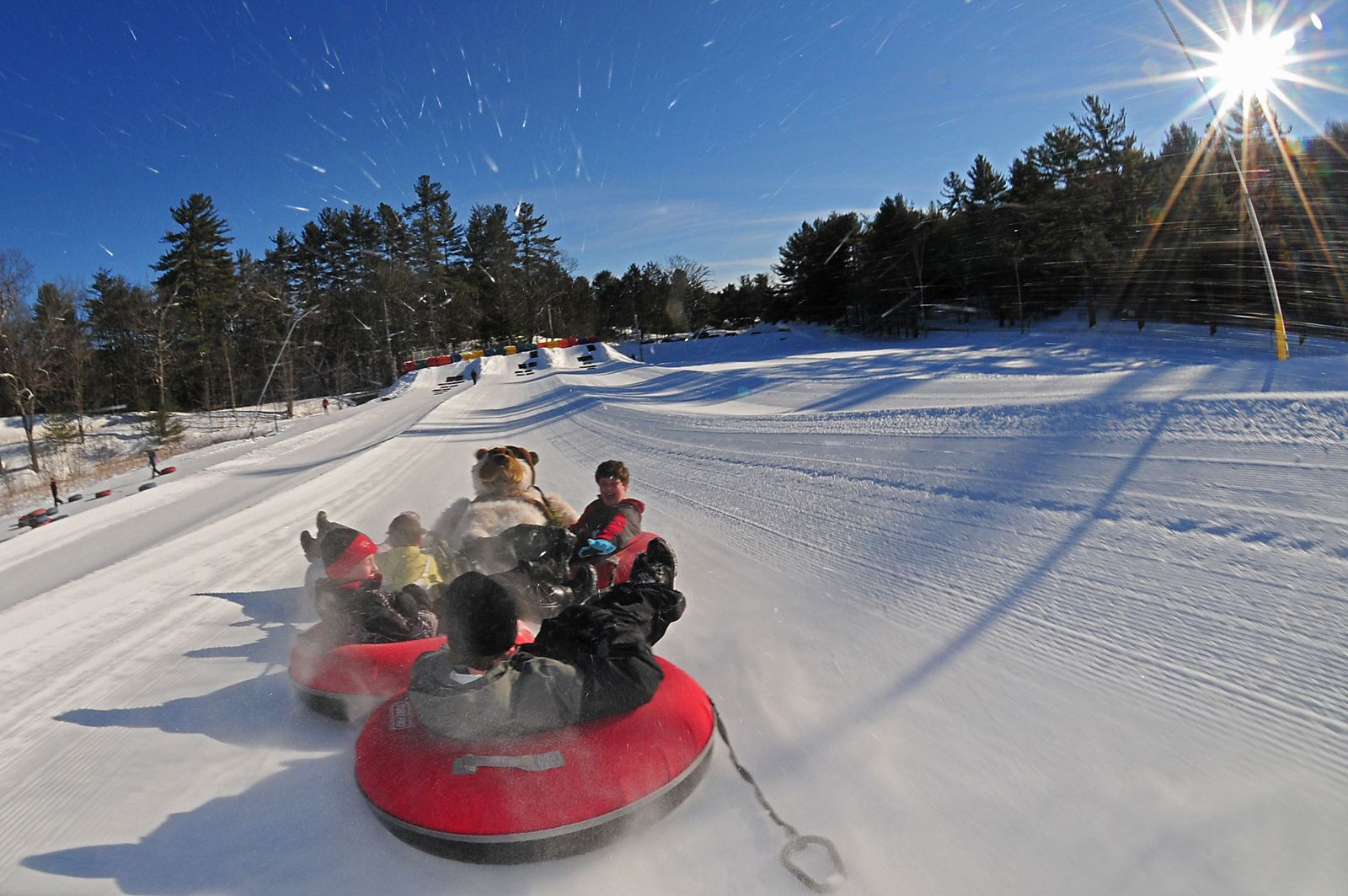 snow tubing at king pine ski area. a must for winter family reunions