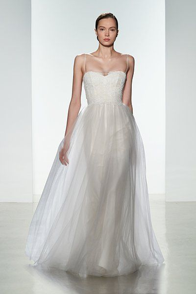Getting married in a destination wedding? This ethereal Christos gown embraces a laid-back, barefoot-on-the-beach vibe.