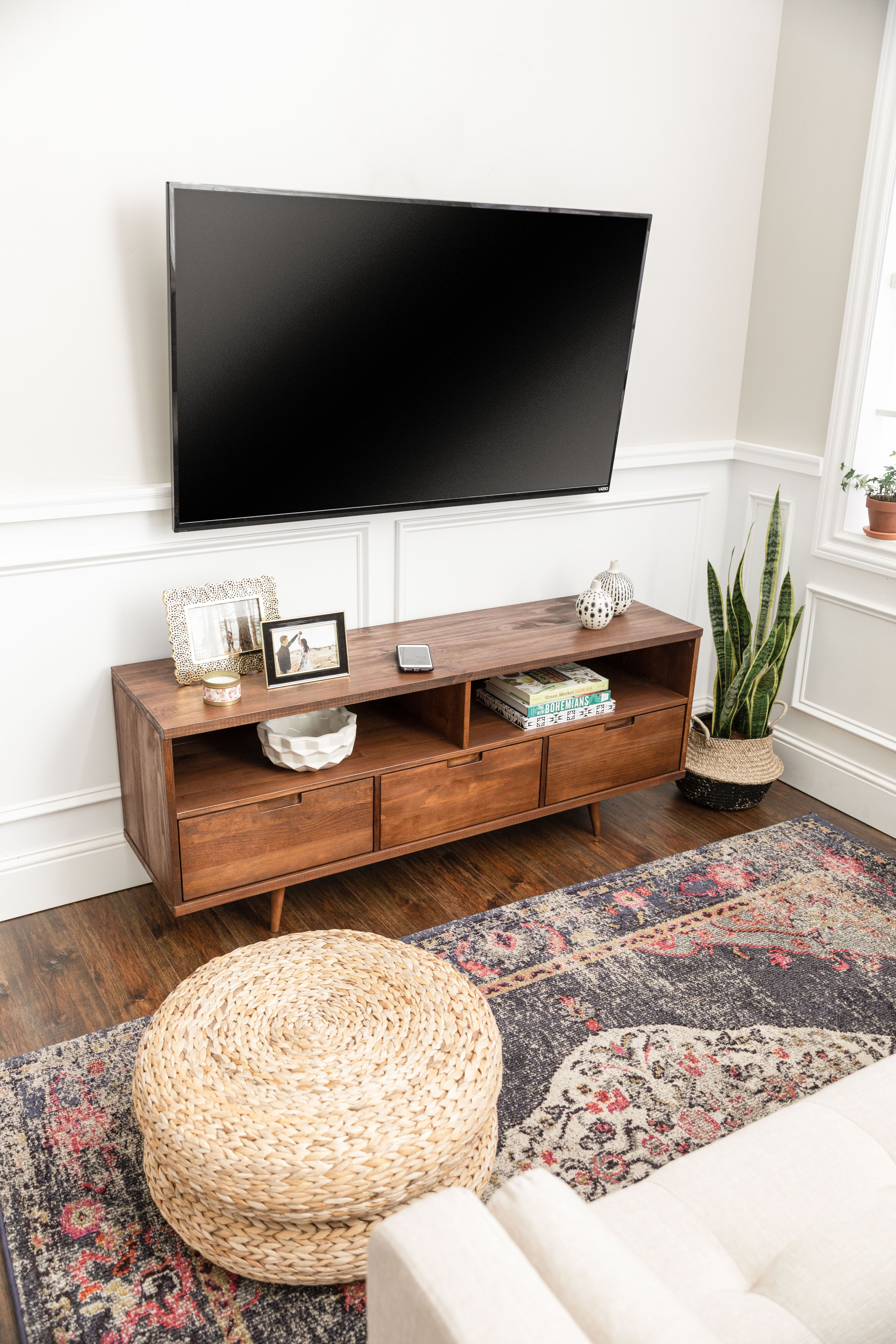 Boho Styled Living Room Featuring A Snake Plant Love Our Midcentury Ivy Tv Stand Wit Modern Bohemian Living Room Living Room Tv Stand Living Room On A Budget