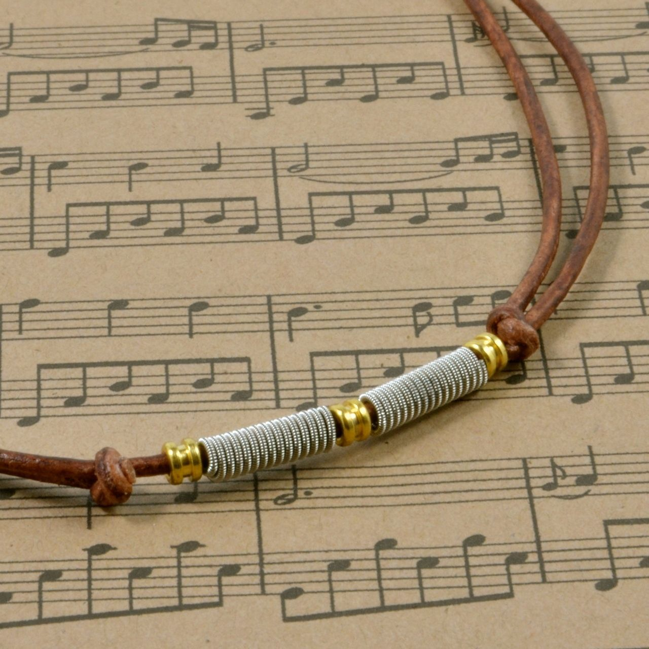 Recycled guitar string jewelry - Adjustable Leather Recycled Guitar String Coil Necklace With Ball End Beads High Strung Studios