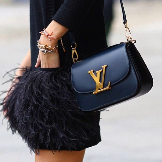 This gorgeous Louis Vuitton fall handbag contrasts perfectly with feathers.