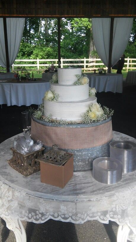 3 Tier Rustic Wedding Cake With White Roses Babies Breath Galvanized Bucket Cake Stand With Burla Galvanized Wedding Ideas Wedding Cakes Wedding Cake Stands