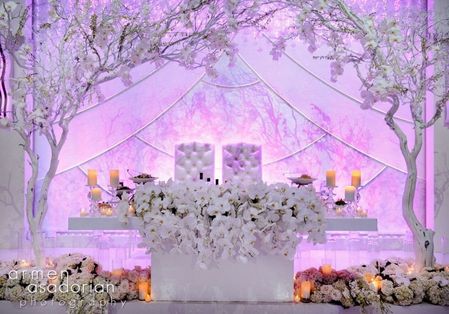 Beautiful White Wedding Theme Orchid Head Table Decor With Bride