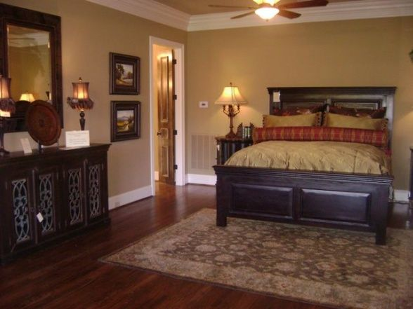 Dark Furniture, Gold And Red Bedding With Gold Walls And Bright White Trim.