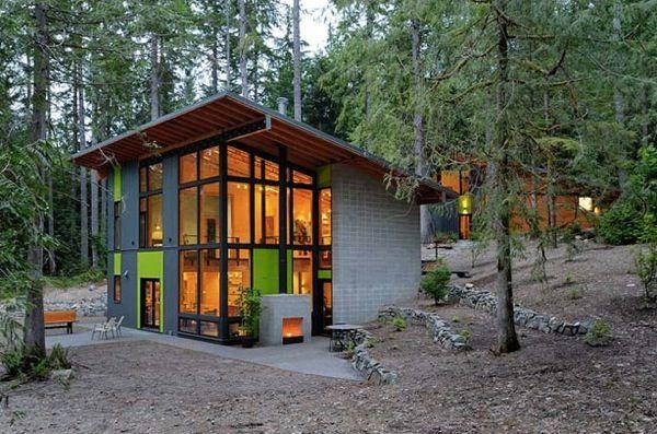 love this modern house in the forest Casas prefabricadas de madera