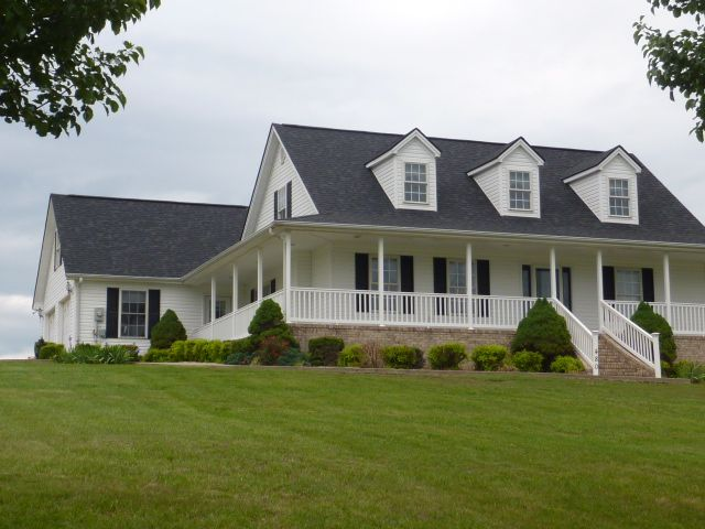 We like this design high pitch roof wrap around porch for Cape cod dormer plans