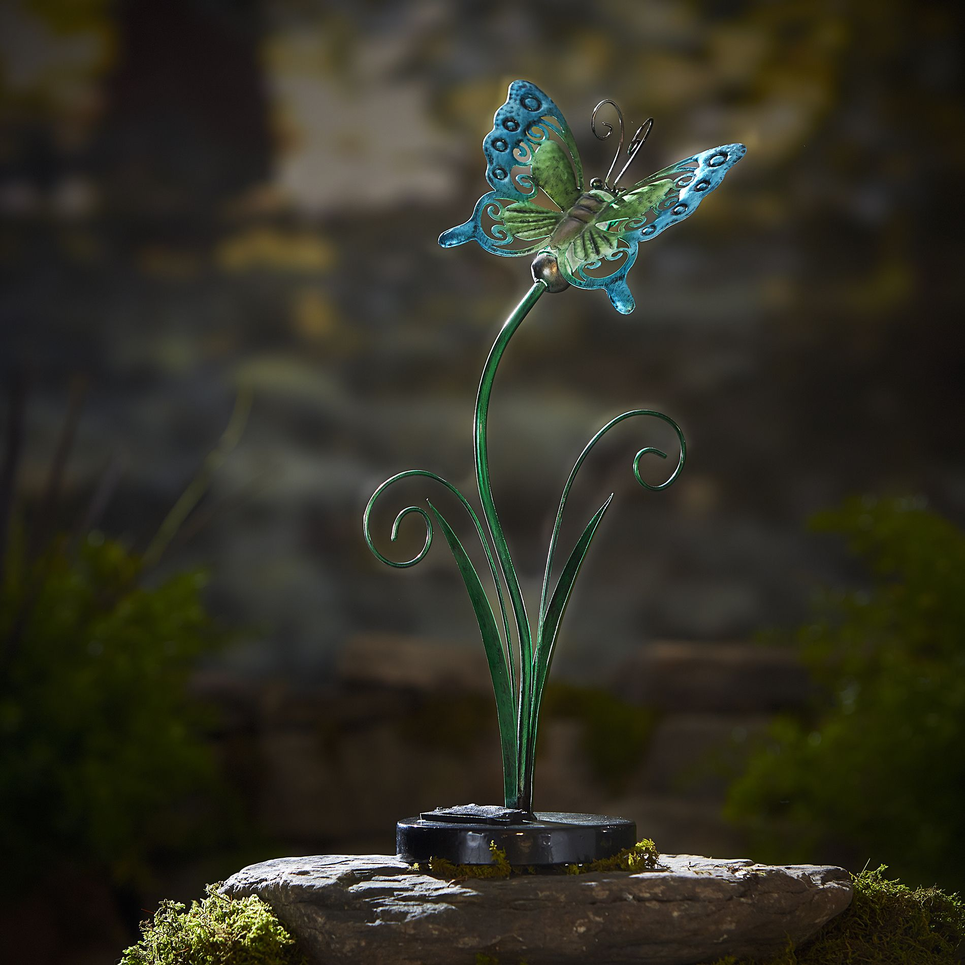 90%METAL10%SOLAR LIGHT -This sculpture has some beautiful lines and beautifully colored ,also the solar light can recharges in the sun and lights up at night to bright garden day and night .
