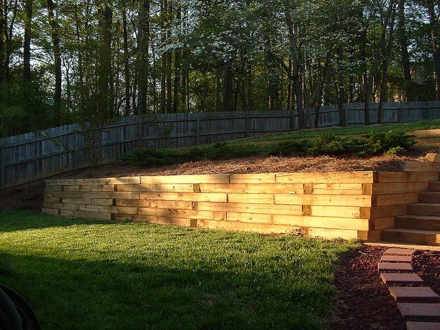 Crosstie retaining wall | Retaining walls, Yard crashers and Outdoor ...