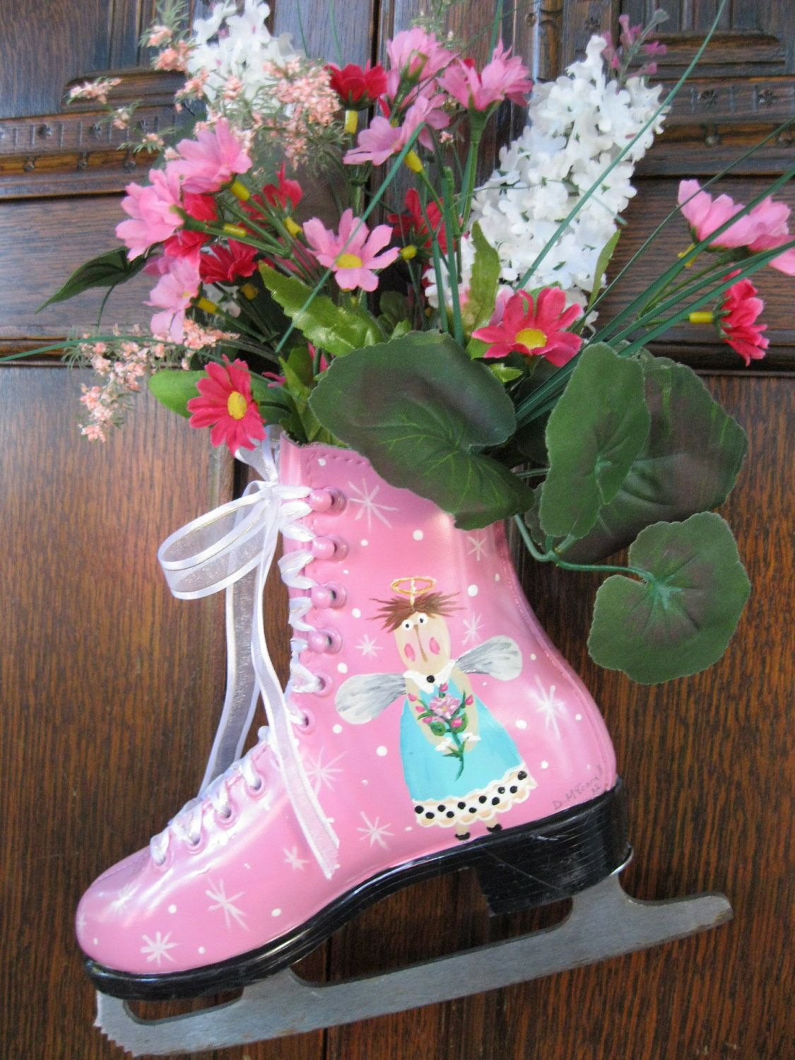 Handpainted Shabby Chic Christmas figure skate Flower Arrangement with Angel in Pink and Aqua. $35.00, via Etsy.