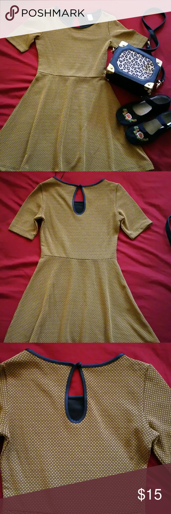 H&M Divided dress Selling a like new divided dress from H&M great condition love the pattern and lining is a leather like texture super fitted and true to size US 4 mustard yellow color with black. beautiful dress for any occasion or the summer goes well with flats and a cute purse (purse and flats not for sale not included ) H&M Dresses Midi