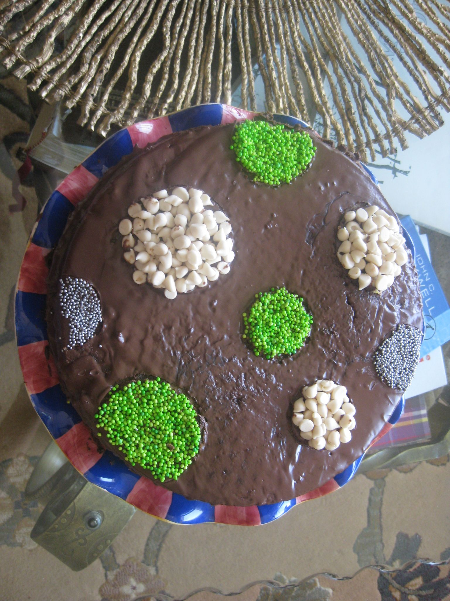 Polka dot cake!  Use cookie cutters as stencils to make different shapes on top of your cakes.   Use any cake, any topping, any cookie cutter shape and any sprinkles or other decorations.