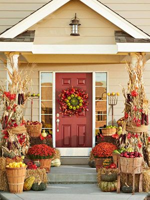 Fall porch - love the red front door, corn stalks and hay bales.