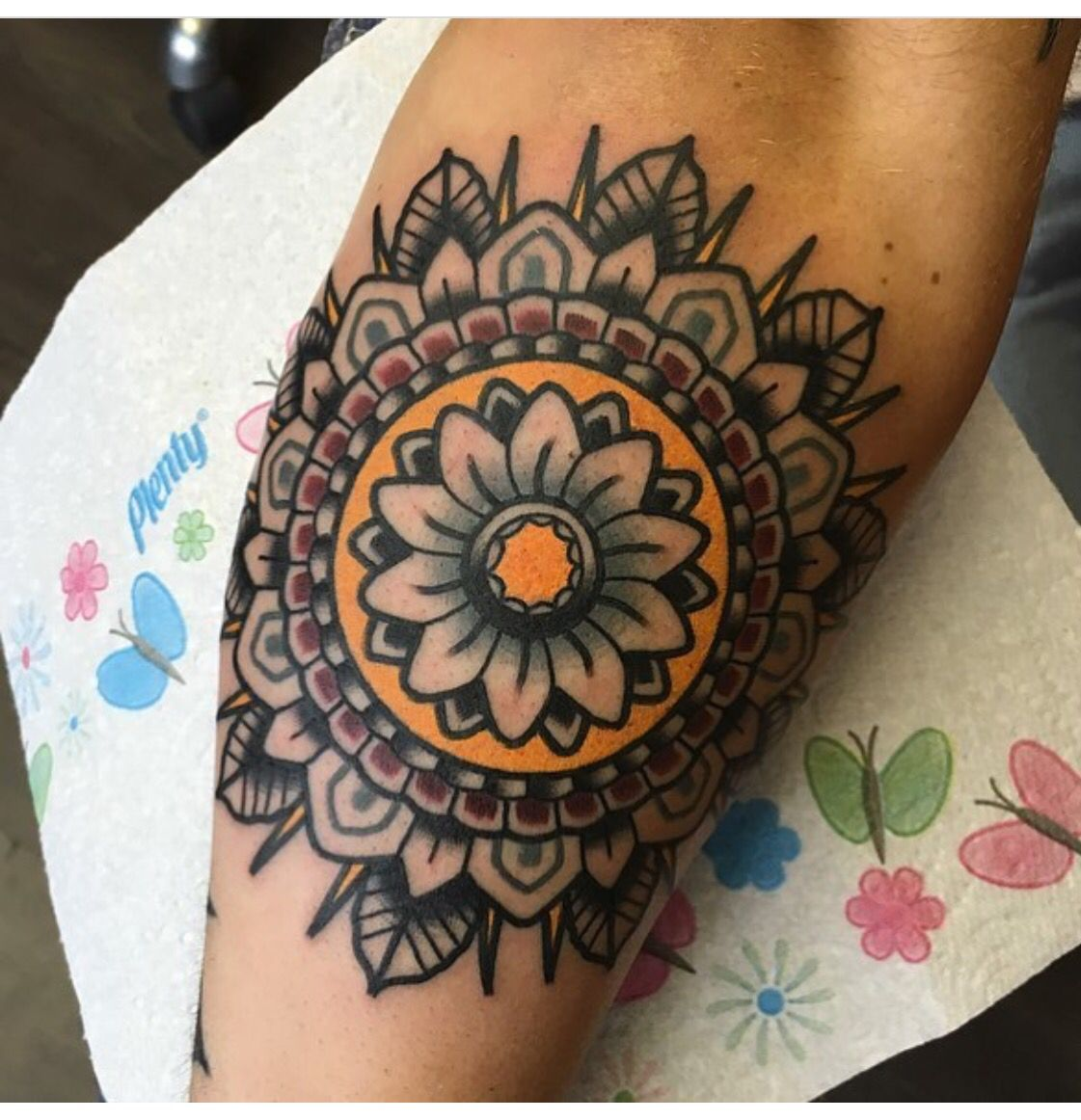 Tattoo mandala on forearm, deep red black grey and gold. #tattoo #ink #traditional #mandala