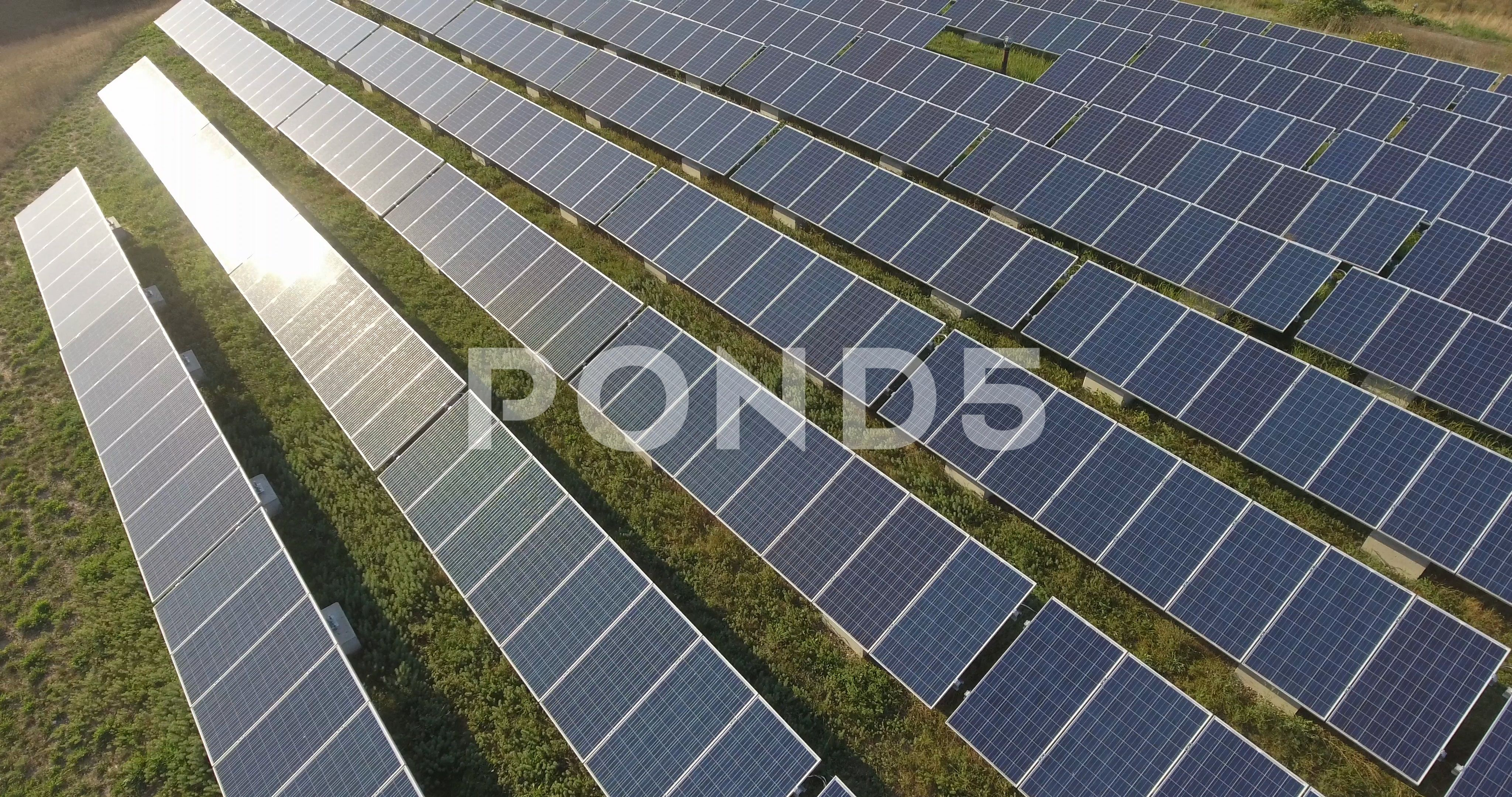 Solar Panels Aerial Of Photovoltaic Array At Energy Farm 4k Drone Stock Footage Photovoltaic Array Aerial Solar Solar Farm Solar Photovoltaic