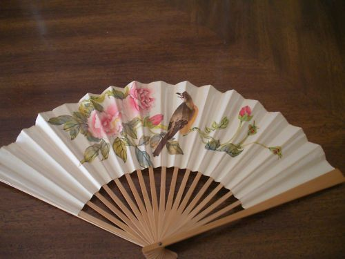 Paper Fan...we got new ones every year usually at Woolworth's....there wasn't air conditioning