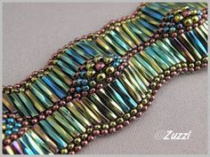 """""""Egyptian wave"""" bracelet  is floating around from Zuzzl's website, no attribution.  The source is from Met Innmon - if interested, a 2008 copy-write kit can be found at http://www.metbeads.com/metinnmon/Kits.html   Met may teach this at B&B events from time to time."""