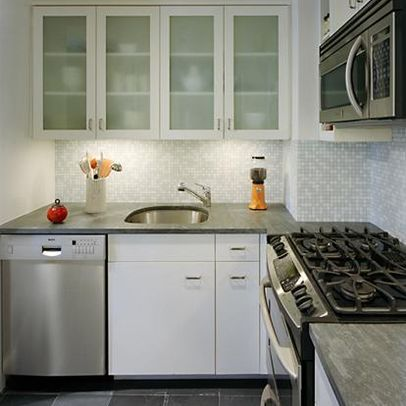 24 Pictures Of Kitchens With Glass Cabinets Glass Kitchen