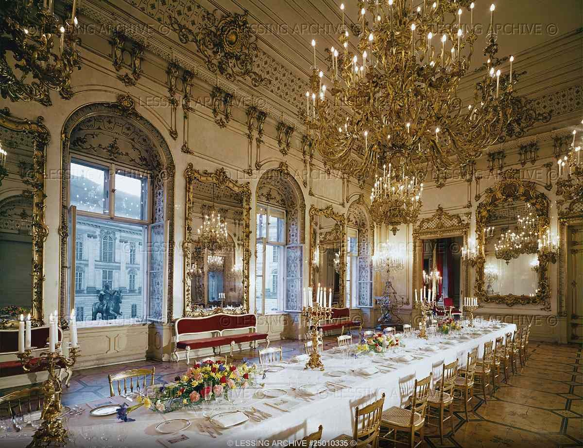 main dining room of the pallavicini palace with the table laid for