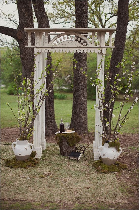 vintage wedding arch backdrop #weddingceremony #rusticwedding #weddingchicks http://www.weddingchicks.com/2014/02/11/blue-and-coral-backyard-wedding/
