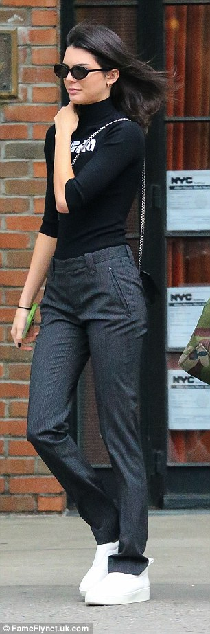 She likes dark colours! Kendall was spotted out later in formal trousers with a sweater tu...