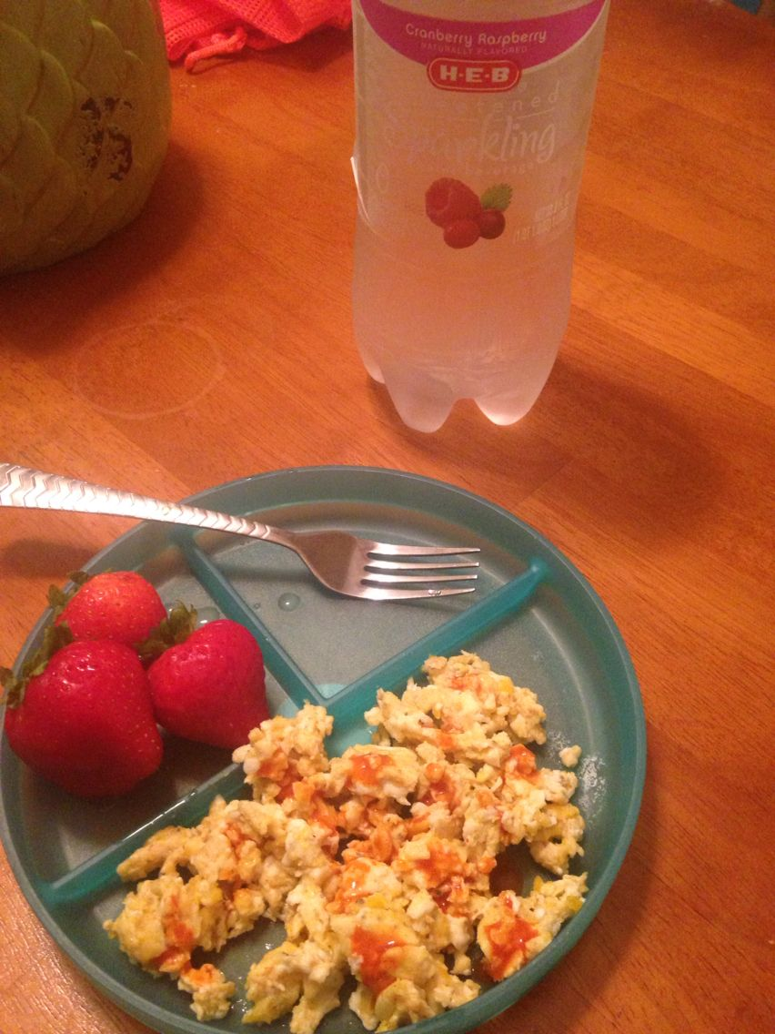 Day 1 of Whole30 breakfast- Scrambled eggs (2) Chalula, Strawberries (3), sparkling water