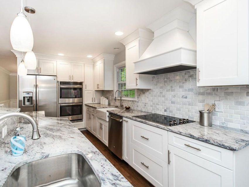 White Cabinet Kitchen With Marble Countertops And Marble Tile