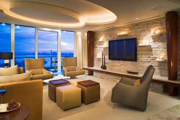 The Most Elegant Design Possibilities To Use For The Living Area Stonewall Http Ww Stone Wall Interior Living Room Living Area Design Interior Design Firms
