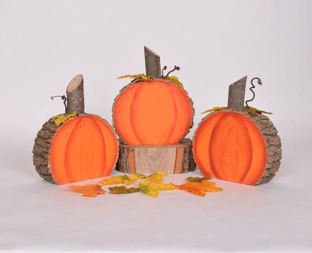 painted tree sections and embellished with leaves pumpkins