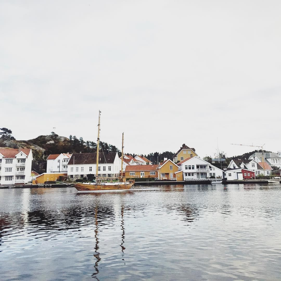 Wooden ships on the fjord. Mandal, Norway.