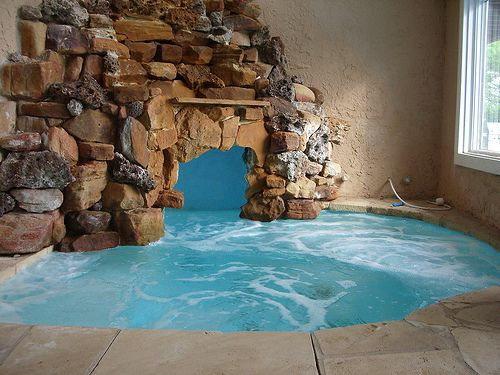 awesome indoor pool cave turquoise water with cooler grey tone