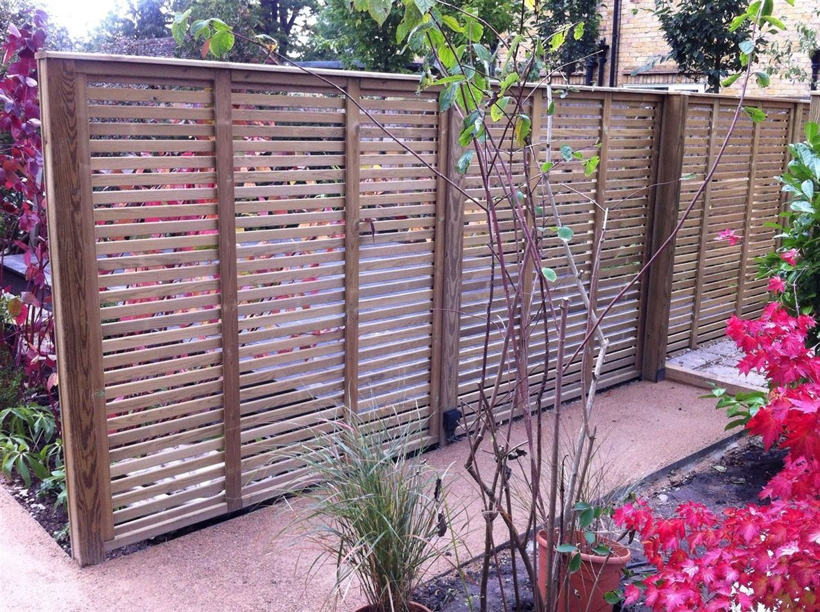 Slatted fence panel used as a garden screen, ideal for