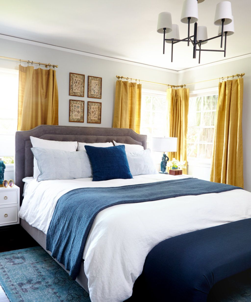 Mustard yellow curtains give the perfect classic POP to this pretty bedroom. Mustard yellow curtains give the perfect classic POP to this