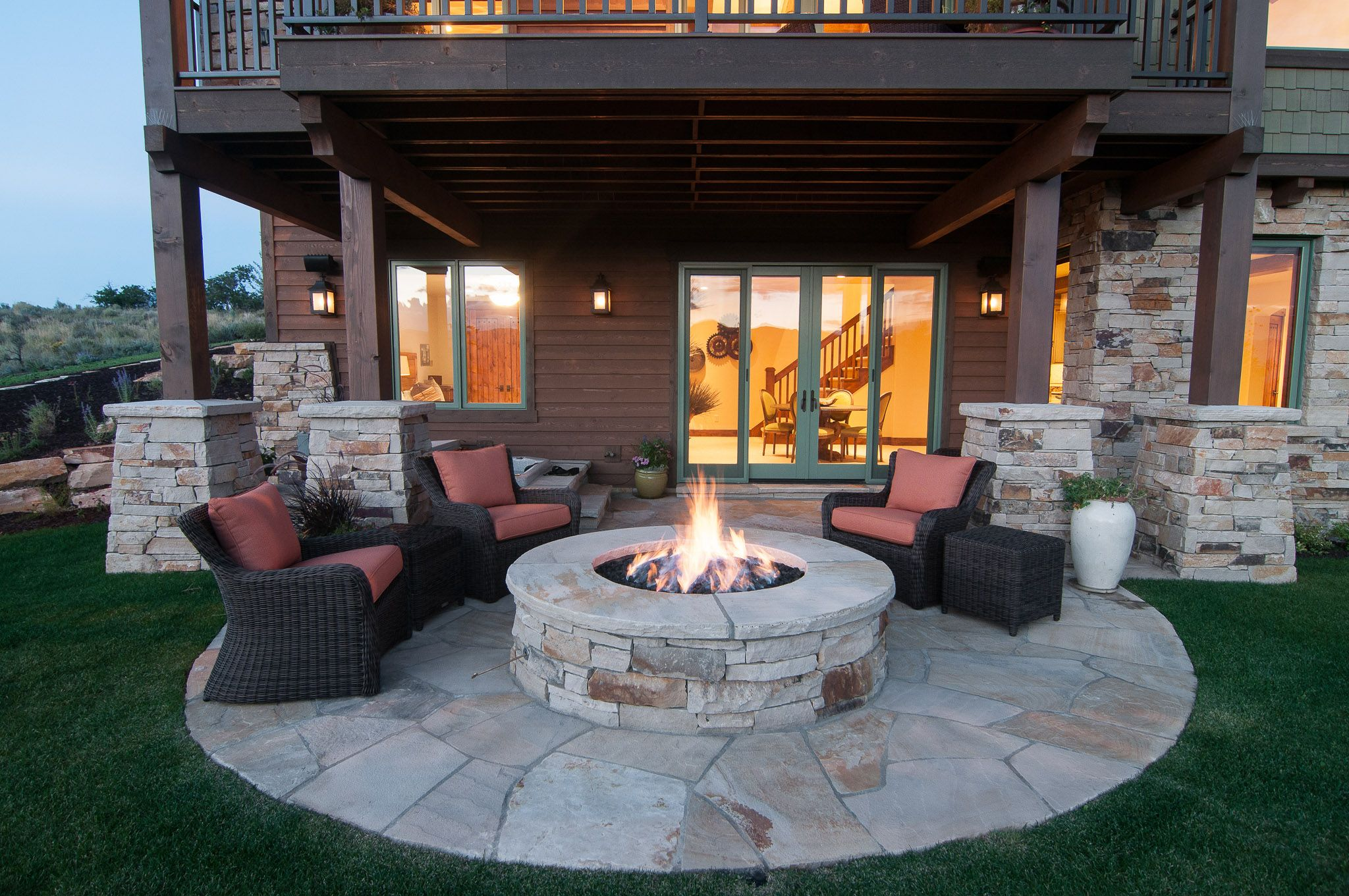 Back Patio with firepit in Tuhaye Home built by Cameo Homes Inc