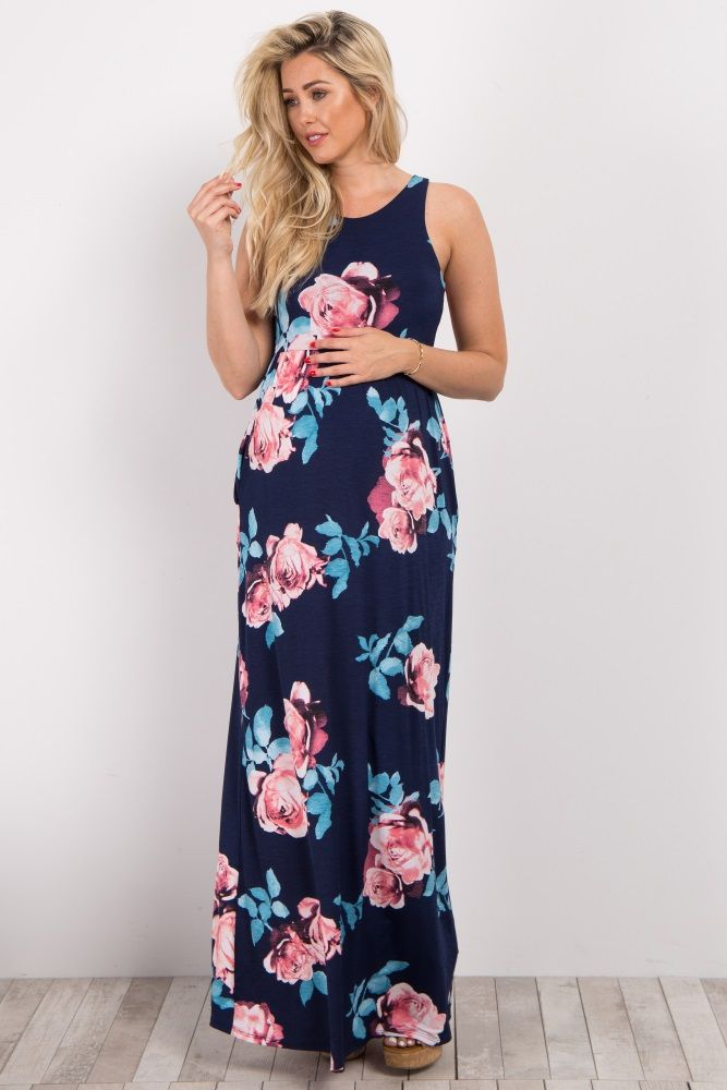 8de8a761c808f Navy Blue Rose Floral Sleeveless Maxi Dress Floral printed maternity maxi  dress. Sleeveless. Cinched at waist. Rounded neckline. Front pockets.