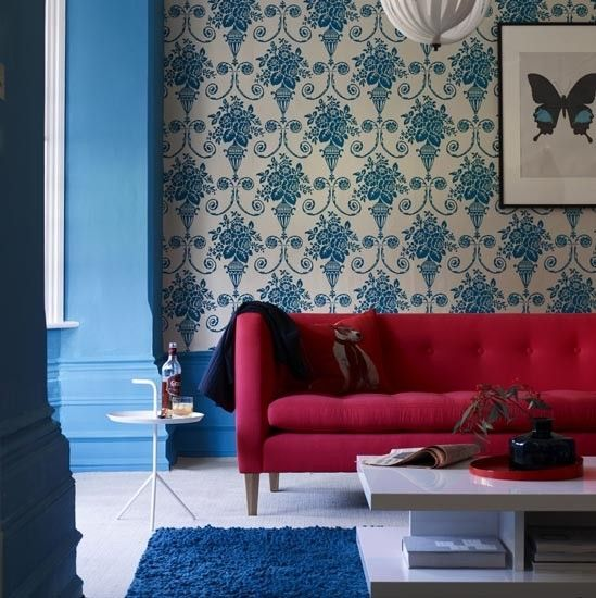 Coral And Blue Living Room A Wallpapered Feature Wall Is Striking Focal Point In This