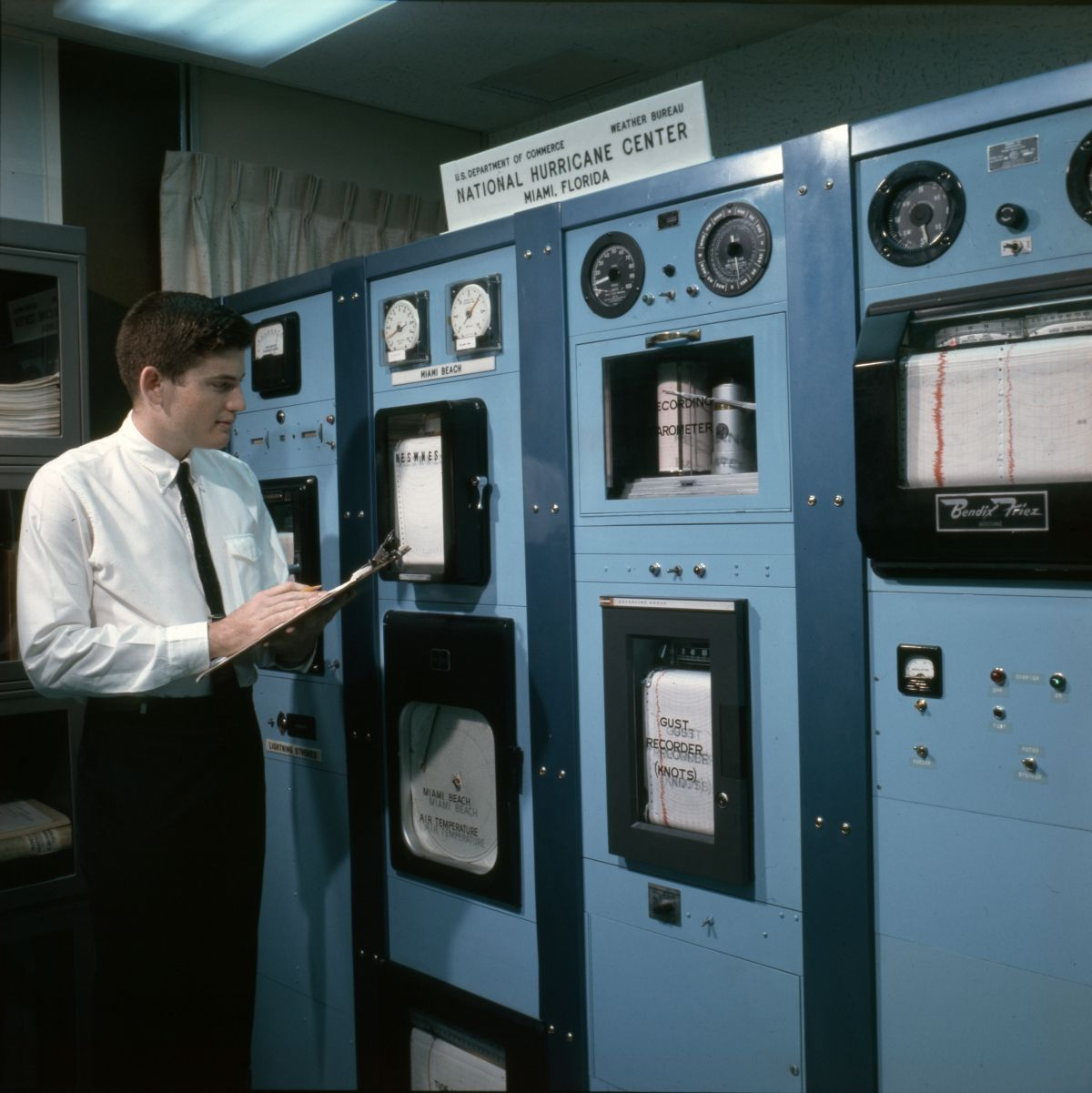 A Meteorologist Viewing Instruments At The U S Department Of Commerce Weather Bureau Nati National Hurricane Center Florida Hurricane Florida Hurricane Season