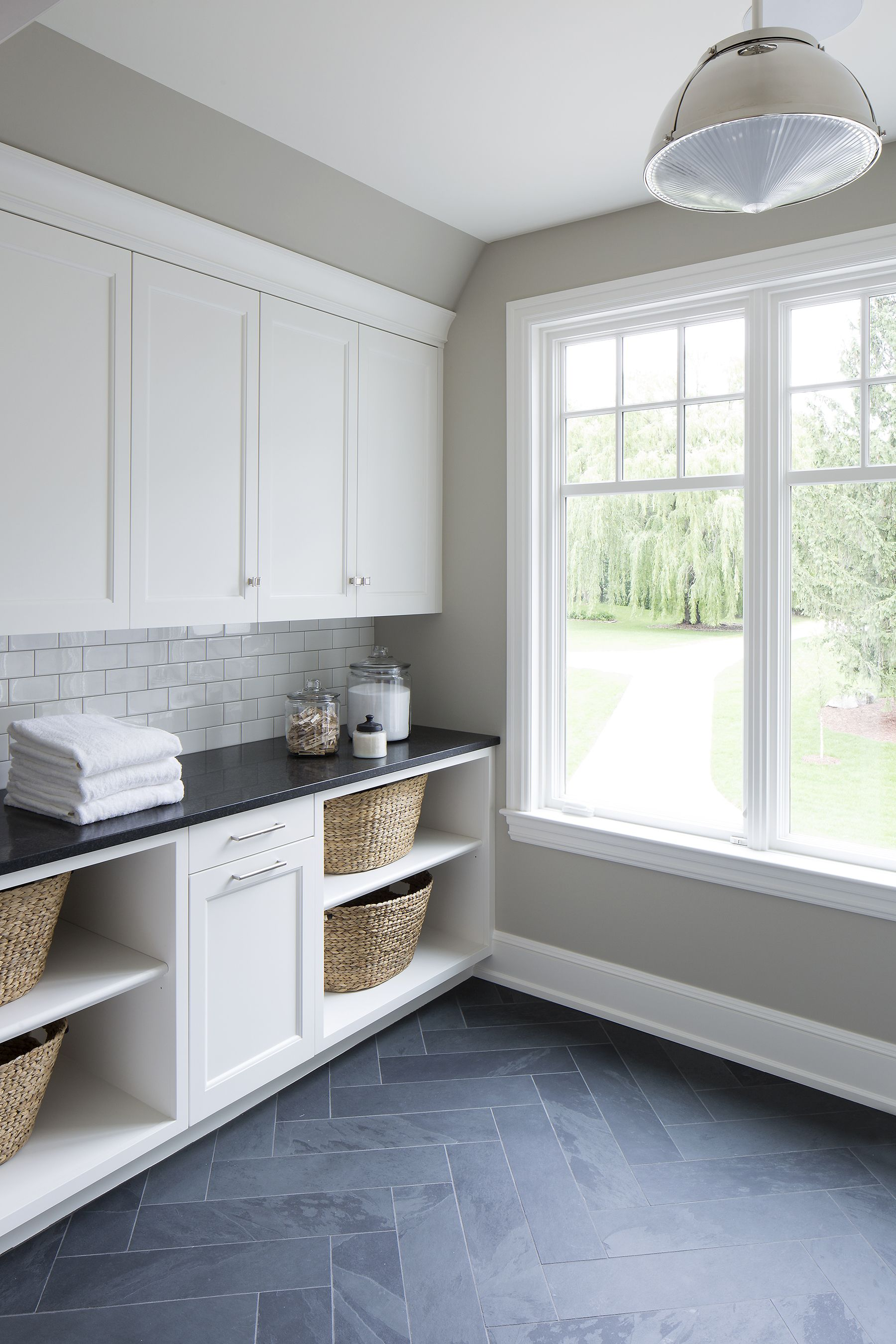 Herringbone tile slates in laundry room Design by Vivid Interior Design Danielle Loven