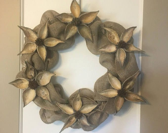 Photo of Natural milkweed pod and sweetgum flower garland in gold