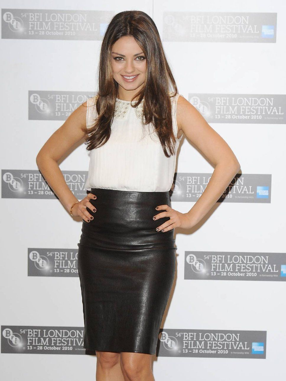 d97cf0c623be Mila Kunis In A Black Leather Skirt