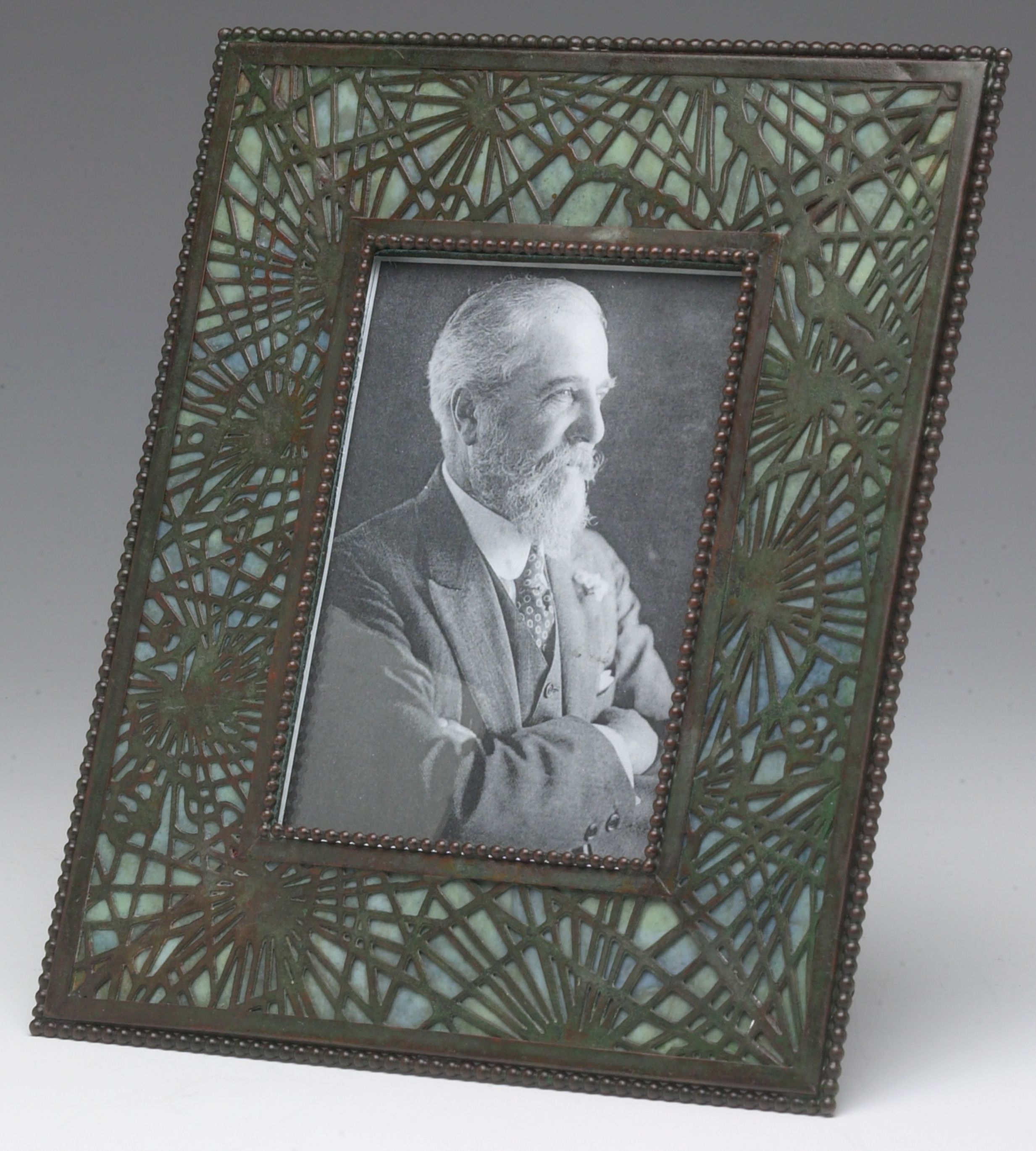 A tiffany studios pineneedle pattern picture frame circa 1910 a tiffany studios pineneedle pattern picture frame circa 1910 provenance treadway gallery a tiffany studios etched metal glass picture frame jeuxipadfo Image collections