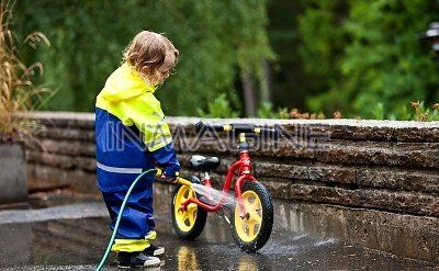 Boy washing bicycle photo